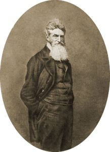 John Brown with hands in pockets, facing the camera.